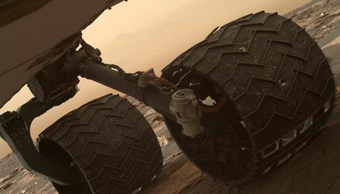 Two of the raised treads, called grousers, on the left middle wheel of NASA's Curiosity Mars rover broke during the first quarter of 2017, including the one seen partially detached at the top of the wheel in this image from the Mars Hand Lens Imager (MAHLI) camera on the rover's arm. (NASA/JPL-Caltech/MSSS)
