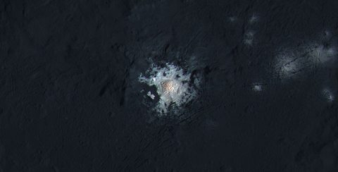 The bright spots in the center of Occator Crater on Ceres are shown in enhanced color in this view from NASA's Dawn spacecraft. (NASA/JPL-Caltech/UCLA/MPS/DLR/IDA/PSI/LPI)