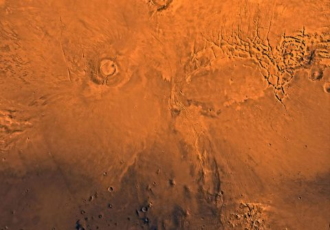 New research using observations from NASA's Mars Reconnaissance Orbiter indicates that Arsia Mons, one of the largest volcanos on Mars, actively produced lava flows until about 50 million years ago. This wide view of the volcano is from the Viking 1 Orbiter. (NASA/JPL/USGS)