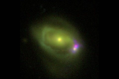 "This optical image shows the Was 49 system, which consists of a large disk galaxy, Was 49a, merging with a much smaller ""dwarf"" galaxy Was 49b. (DCT/NRL)"