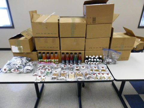 Tennessee Highway Patrol officers make traffic stop and discover boxes in bed of truck filled with marijuana, 64 pounds of THC edibles and 263 bottles (3,156 fluid ounces) of THC infused drinks and syrup.