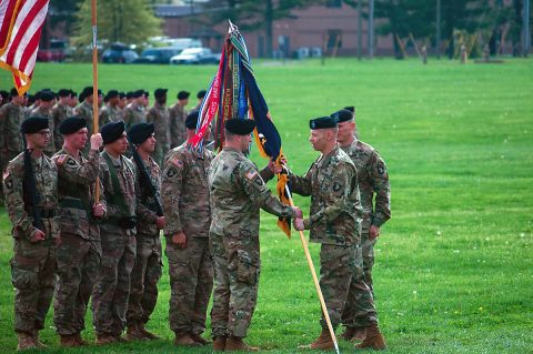 U.S Army Col. Brett Sylvia, commander, 2nd Brigade Combat Team, 101st Airborne Division (Air Assault), right, hands the guidon to Lt. Col. Keith Carter, commander, 1st Battalion, 26th Infantry Regiment, left, during a change of responsibility ceremony, Apr. 18, 2017, at Fort Campbell, Kentucky. Carter is taking over 1-26 from Lt. Col. Ryan Wylie, who led the unit since its activation at Fort Campbell. (U.S Army Photo by 1st Lt. Daniel Johnson)