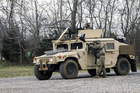 A squad leader with 1st Platoon, 194th Military Police Company, 716th MP Battalion, 101st Airborne Division (Air Assault) Sustainment Brigade, 101st Abn. Div., directs a Soldier, March 14, 2017, as the platoon establishes a traffic control point during a platoon external evaluation on Fort Campbell, Kentucky. (Sgt. Neysa Canfield/101st Airborne Division Sustainment Brigade Public Affairs)