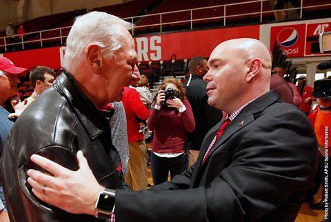 Retired APSU head coach Dave Loos (left) congratulates Matt Figger (right), Thursday. (APSU Sports Information)