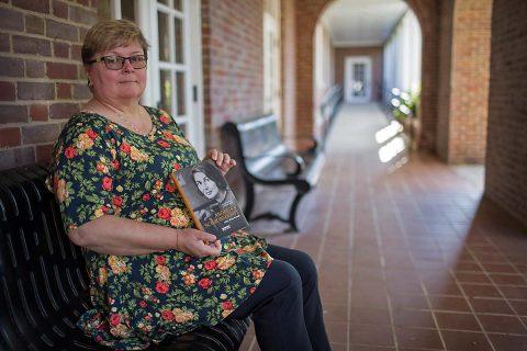 "APSU's Dr. Beatrix Brockman with her book ""Angelika Schrobsdorff: Leben ohne Heimat""."