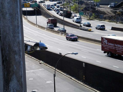 (At left), Air quality equipment monitors traffic-related air pollution on a New York City highway. (The MESA Air Study)