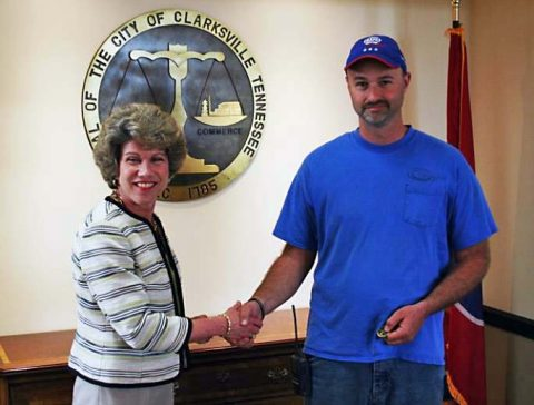 Clarksville Mayor Kim McMillan thanks Jody Biter, Clarksville Gas and Water service technician, for his quick actions Wednesday to help an elderly woman who had fallen from a porch.