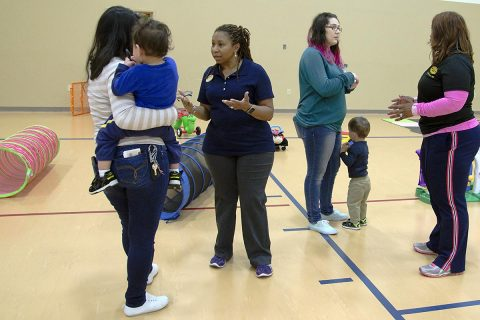 Griscelda Perez, (left), speaks with Phalecian Rawlins, Family Advocacy Program specialist, while she holds her son, Alexis, 21 months, April 6, 2017, at Taylor Youth Center on Fort Campbell, Kentucky. Rawlins was explaining what normal behavior is for Alexis's age and telling Perez about the other programs FAP offers. Play Morning is from 9-10:30 a.m. every Thursday and is geared toward children younger than 3. (Heather Huber, Fort Campbell Public Affairs Office)