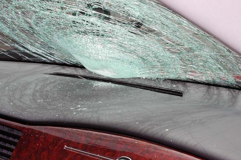 Chevy Impala strikes a pedestrian crossing Madison Street, Wednesday.