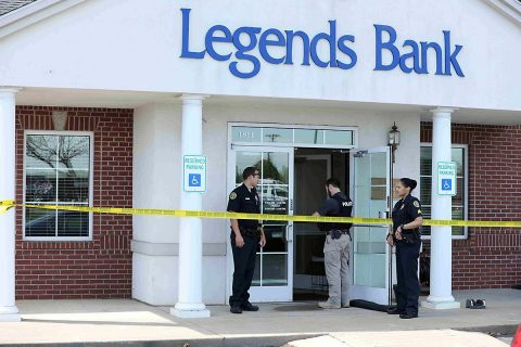 Clarksville Police investigating the robbery at Legends Bank Monday.