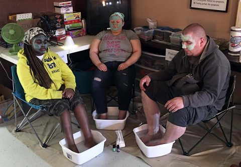 Psychosocial Recovery clients enjoy a foot spa.