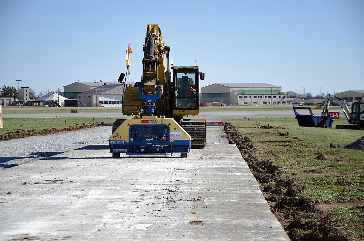 Construction equipment with suction devices that can lift concrete slabs from taxiways at Campbell Army Airfield will speed repairs to CAAF and make them cheaper since it preserves the rock subbase. The repairs are part of a $28 million contract awarded by the Army Corps of Engineers. (Leejay Lockhart, Fort Campbell Public Affairs Office)