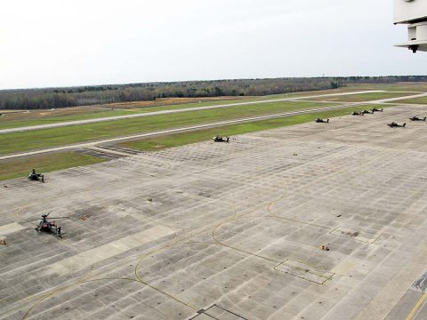 Sabre Army Airfield normally serves rotor wing aircraft such as these AH-64 Apache attack helicopters parked on a ramp across from the runway March 30, 2017. However, in coming weeks fixed wing aircraft such as C-17s will make use of the runway while Campbell Army Airfield undergoes repairs. (Leejay Lockhart, Fort Campbell Public Affairs Office)