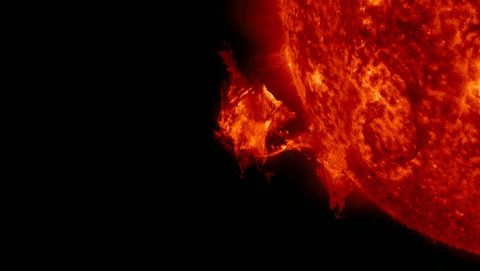 A solar eruption on Sept. 26, 2014, seen by NASA's Solar Dynamics Observatory. If erupted solar material reaches Earth, it can deplete the electrons in the upper atmosphere in some locations while adding electrons in others, disrupting communications either way. (NASA)