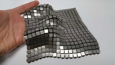 "This metallic ""space fabric"" was created using 3-D printed techniques that add different functionality to each side of the material. (NASA/JPL-Caltech)"