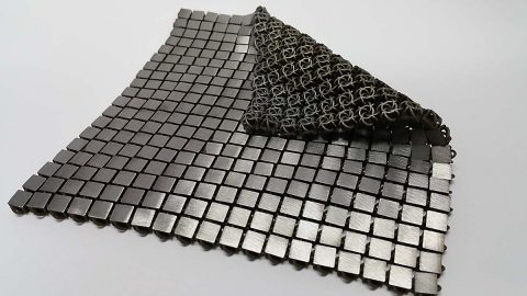 """Another example of a 3-D-printed metallic """"space fabric."""" The bottom and top sides of the fabric are designed to have different functionality. (NASA/JPL-Caltech)"""