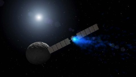 This artist's rendering shows NASA's Dawn spacecraft maneuvering above Ceres with its ion propulsion system. (NASA)