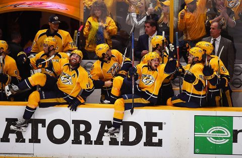 Nashville Predators players celebrate in the closing seconds of a win against the Chicago Blackhawks in game four of the first round of the 2017 Stanley Cup Playoffs at Bridgestone Arena. The Predators won 4-1 to eliminate the Blackhawks. (Christopher Hanewinckel-USA TODAY Sports)