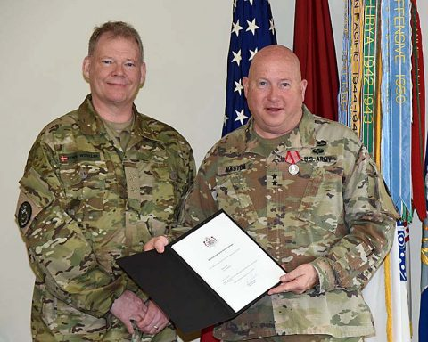 Right, Maj. Gen. Max Haston, the Adjutant General of the Tennessee National Guard, received the Danish Home Guard Meritorious Service Medal from Danish Maj. Gen. Finn Winkler, commander of the Danish Home Guard, at a ceremony at the Tennessee National Guard Joint Force Headquarters on March 27th. (Army Staff Sgt. William Jones/TNNG/Released)