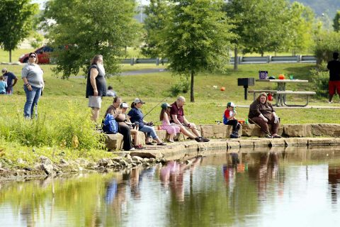 """Clarksville Police Department held """"Cops and Bobbers"""" Saturday at Liberty Park pond."""
