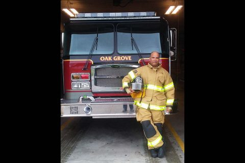 Sergeant 1st Class Julio Mella, 21st Brigade Engineer Battalion, 3rd Brigade Combat Team, 101st Airborne Division poses in front of a firetruck at the Oak Grove Fire Department. Mella has been volunteering as a firefighter and EMT with the department since 2008 and decided he wanted a picture in his full gear before he deployed in November 2016. (Fort Campbell Public Affairs Office)