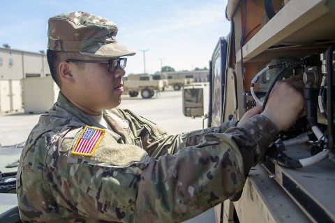 Specialist Jesse Thepouhthay, an air traffic control equipment repairer assigned to F Company, 6th Battalion, 101st General Support Aviation Battalion, 101st Combat Aviation Brigade, 101st Airborne Division, conducts checks in the motorpool May 16, 2017. Thepouhthay's role model is his father, who immigrated to America from Laos. (Leejay Lockhart, Fort Campbell Public Affairs Office)