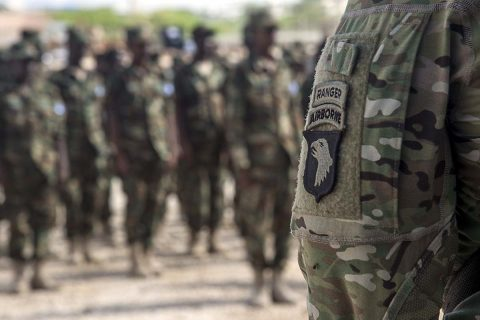 Five U.S. Army 101st Airborne Soldiers deployed with U.S. Army Africa to train Somali National Army soldiers stand at a graduation formation on May 23, 2017, in Mogadishu, Somalia. The six-week logistics course focused on various aspects of moving personnel, equipment and supplies. (U.S. Air National Guard, Tech. Sgt. Joe Harwood)