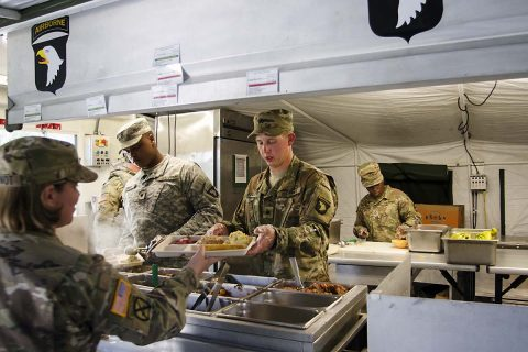 Sergeant Brandon Keller and Spc. Ontroy Canty, food service specialists assigned to E Company, 6th Battalion, 101st General Support Aviation Battalion, 101st Combat Aviation Brigade, 101st Airborne Division, serve breakfast during an aerial refueling exercise for the field feeding portion of the Philip A. Connelly Program May 11, 2017 at Fort Campbell, Kentucky.(Leejay Lockhart, Fort Campbell Public Affairs Office)