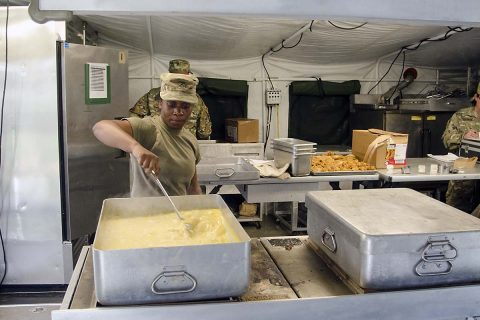 Private 1st Class Desiree Slaton, a food service specialist assigned to E Company, 6th Battalion, 101st General Support Aviation Battalion, 101st Combat Aviation Brigade, 101st Airborne Division, prepares potatoes au gratin for the field feeding portion of the Philip A. Connelly Program May 11, 2017, at Fort Campbell, Kentucky.  (Leejay Lockhart, Fort Campbell Public Affairs Office)