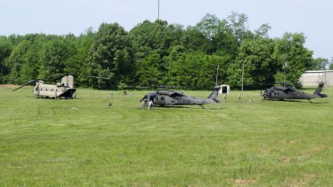 "Soldiers from E Company, 6th Battalion, 101st General Support Aviation Battalion, 101st Combat Aviation Brigade, 101st Airborne Division, rush to refuel two UH-60 Black Hawk helicopters as part of a ""fat cow"" mission, where a CH-47 Chinook helicopter transports fuel to a forward location May 11, 2017, at Fort Campbell, Kentucky.  (Leejay Lockhart, Fort Campbell Public Affairs Office)"