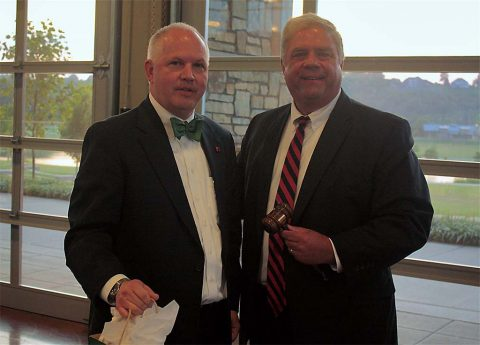 2015-16 Chamber Chairman Tommy Bates and 2016-17 Chairman Sidney Johnson pass the ceremonial gavel during the exchange of leadership at the Chamber's 2016 Annual Dinner & Gala.