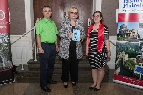 APSU's Phi Alpha Theta presents APSU President Alisa White with the first printing of its now-seventh volume of Theta-Delta. (Cassidy Graves, APSU)