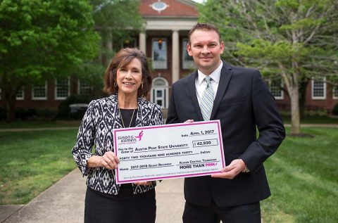 Dr. Nancy Orr with the Susan G. Komen Foundation presents a check to Montgomery County Health Department Director Joey Smith for beast health. (APSU)