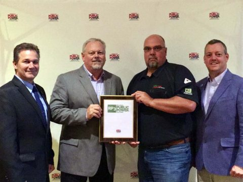 David Lynch, left, Assistant Director of Utility Operations at Marquette Board of Light and Power, Michigan, and chair of the Association's RP3 Review Panel presents the Diamond Level plaque to Brian Taylor, CDE Lightband General Manager, and Keith Cutshall, CDE Lightband Safety Manager. At right is Mike Hyland, Senior Vice President of APPA.