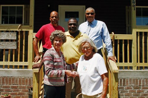 Clarksville Mayor Kim McMillan, front left, hands keys to a new home to Jeannette Hapiuk, along with builder David Adams, back left, and Clarksville officials Martias Kendrick and Keith Lampkin.