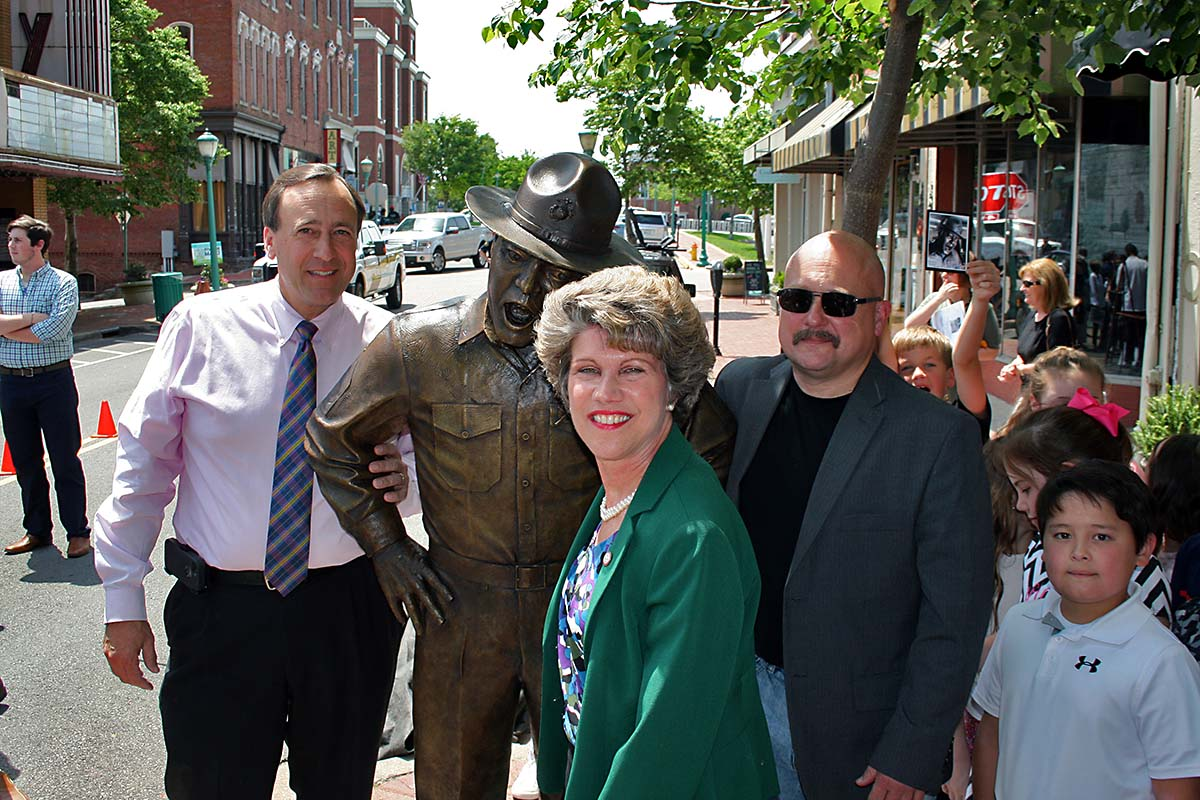 The completed statue of Frank Sutton was unveiled at 1:30pm Wednesday near the Roxy Theatre on Franklin Street by Mark Holleman, Clarksville Mayor Kim McMillan and sculptor Scott Wise.