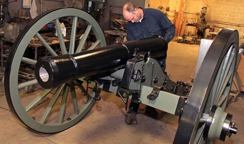Clarksville Foundry patternmaker James Lumpkin puts the finishing touches on the replica Model 1841 6-Pounder Field Gun produced entirely at Clarksville Foundry. The cannon will be unveiled Friday in honor of the Clarksville Rotary Club's 100th Anniversary this month. (Greg Williamson)