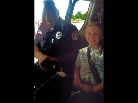 Clarksville Police Officer Evon Parkes with 8 Year Old Quintin Fisher.