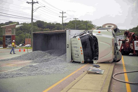 International dump truck rolls over on North Second Street. (Jim Knoll, CPD)