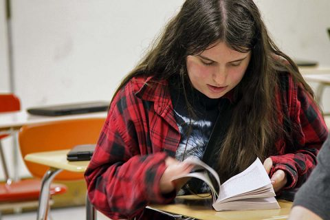 Rebecca Armstrong, a senior at Northeast High School, Clarksville, Tennessee, looks through her book as part of a group assignment, April 24, 2017, during her Advanced Placement Literature class at the high school. (Sgt. Neysa Canfield, 101st Airborne Division Sustainment Brigade Public Affairs Office)
