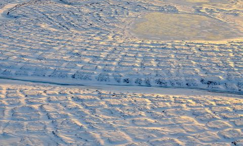 Winter sun setting over the tundra polygons in northern Alaska in November 2015. As winter sets in and snow settles, the soils take time to freeze completely and continue to emit carbon dioxide long into the new year. (NASA/JPL-Caltech/Charles Miller)