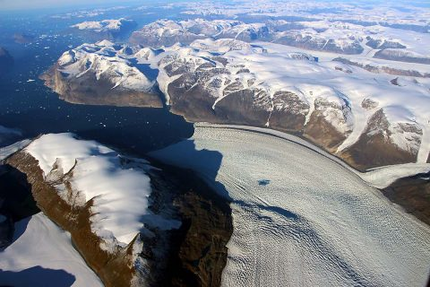 Rink Glacier in western Greenland, with a meltwater lake visible center. (NASA/OIB)