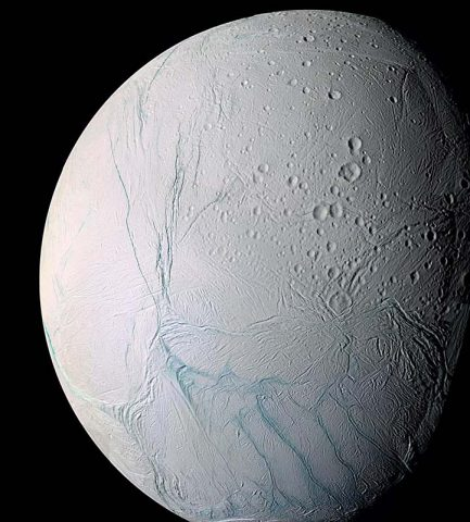 Cassini researchers have found evidence the active south polar region of Enceladus -- the fractured terrain seen here at bottom -- may have originally been closer to the icy moon's equator. (NASA/JPL-Caltech/ Space Science Institute)