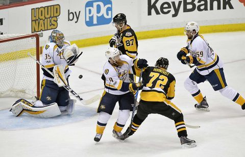 Nashville Predators goalie Pekka Rinne (35) makes a save as Pittsburgh Penguins center Sidney Crosby (87) looks for the rebound during the third period in game one of the 2017 Stanley Cup Final at PPG PAINTS Arena. (Don Wright-USA TODAY Sports)