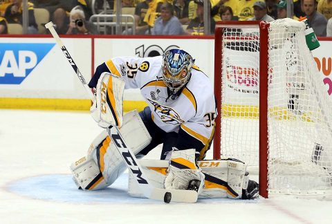 Nashville Predators goalie Pekka Rinne (35) stops the puck against the Pittsburgh Penguins during the first period in game one of the 2017 Stanley Cup Final at PPG PAINTS Arena. (Charles LeClaire-USA TODAY Sports)