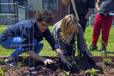 Angie Salamy helping students in garden