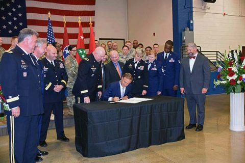 Tennessee Governor Bill Haslam signs the Tennessee STRONG (Support, Training and Renewing Opportunity for National Guard) Act May 25th, 2017 at the Tennessee Department of Military in Nashville. (MSgt Robin Brown, Tennessee National Guard)