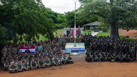 U.S. Army Soldiers assigned to the 1st Battalion, 506th Infantry Regiment, 1st Brigade Combat Team, 101st Airborne Division and Ghana Armed Forces soldiers from the 5th Infantry Battalion, Arakan Barracks, Burma Camp, pose for a group photo during United Accord 2017 at Bundase Training Camp, Bundase, Ghana, May 29, 2017. (U.S. Army photo by Spc. Victor Perez Vargas)