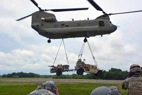 A CH-47 Chinook flown by Soldiers from the 101st Combat Aviation Brigade, 101st Airborne Division (Air Assault), sling loads the Tactical Control Node-Light at Fort Campbell, KY, Jun. 15, 2017. The training was part of 2nd Brigade, 101st's preparation for the upcoming Network Integration Exercise at Fort Bliss, where they will be the first light BCT to participate. (Sgt. Bradford Alex)