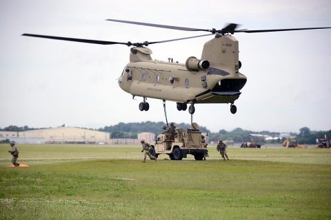 U.S Army Soldiers from the 2nd Brigade Combat Team, 101st Airborne Division (Air Assault), move from under a CH-47 Chinook after successfully hanging up the Tactical Control Node-Light, at Fort Campbell, KY, Jun. 15, 2017. The training was part of the brigade preparation for the upcoming Network Integration Exercise at Fort Bliss, where they will be the first light BCT to participate. (Sgt. Bradford Alex)